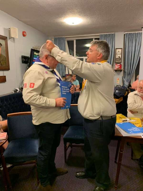 Peter Bodman receiving his Wood Badge